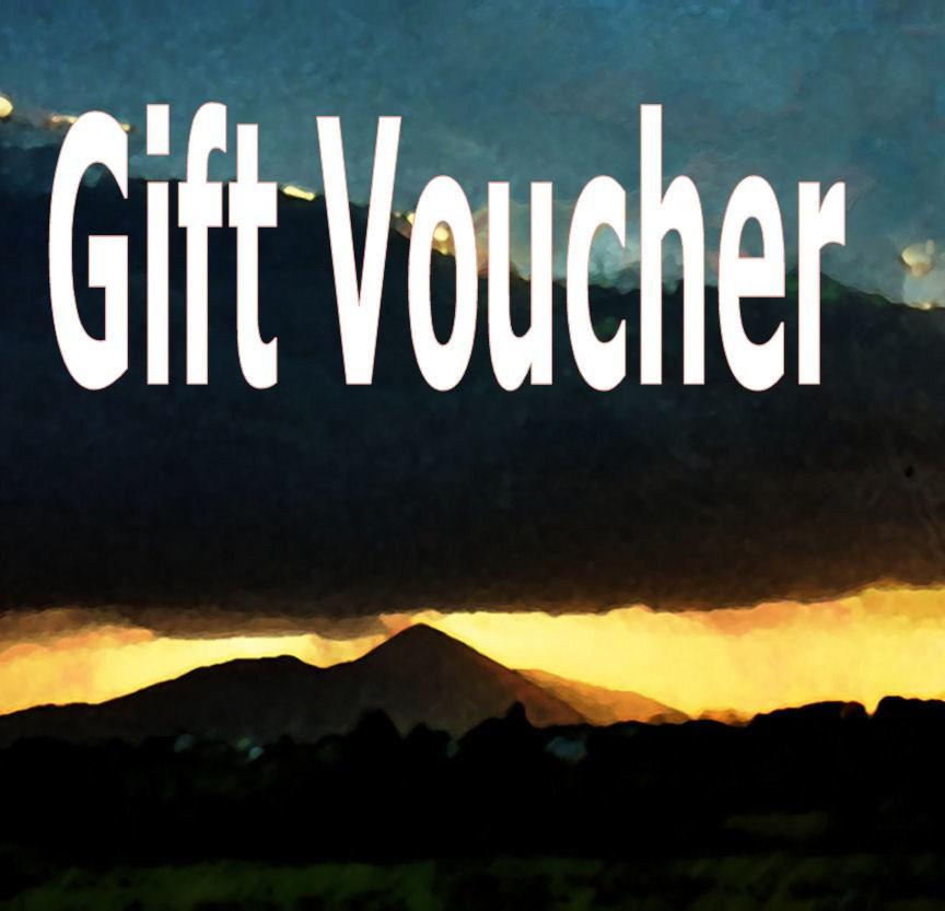 Shows words Gift Voucher over landscape image